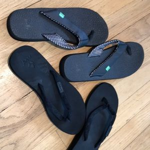 Two pairs of black flip flops - both almost new